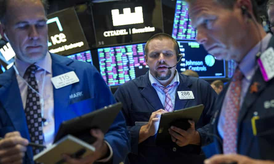 Traders in the New York stock exchange