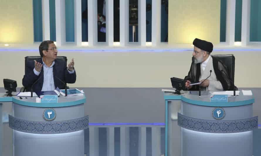 Iranian presidential candidates Abdolnaser Hemmati, left, and Ebrahim Raisi, right, on a television debate, Tehran, 12 June 2021.