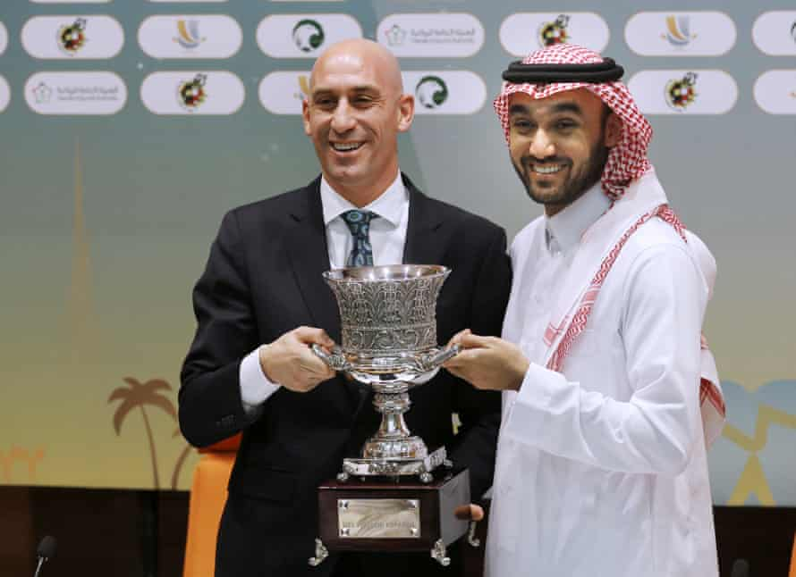 Luis Rubiales, left, and Saudi General Sport Authority chairman Prince Abdulaziz bin Turki Al-Faisal carry the Spanish football Super Cup during a press conference in 2019.