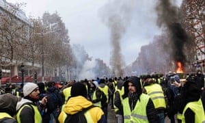 Thousands of protesters stage a demonstration against rising fuel prices in the Champs Élysées in Paris