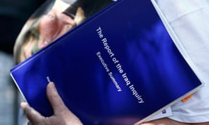 A relative holds a copy of the executive summary of The Report of the Iraq Inquiry, by John Chilcot, at the Queen Elizabeth II centre in London