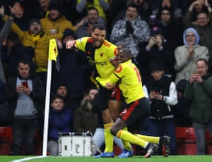 Troy Deeney of Watford celebrates after scoring his team's third goal with teammate Abdoulaye Doucoure.