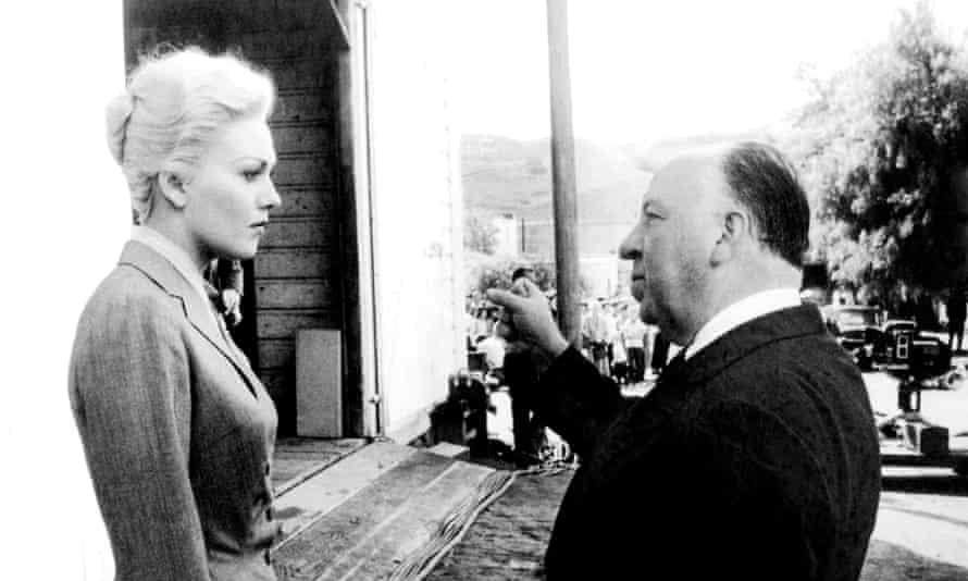 Kim Novak takes direction from Alfred Hitchcock on the set of Vertigo