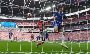 Chelsea's Gary Cahill clears the ball off of the line.