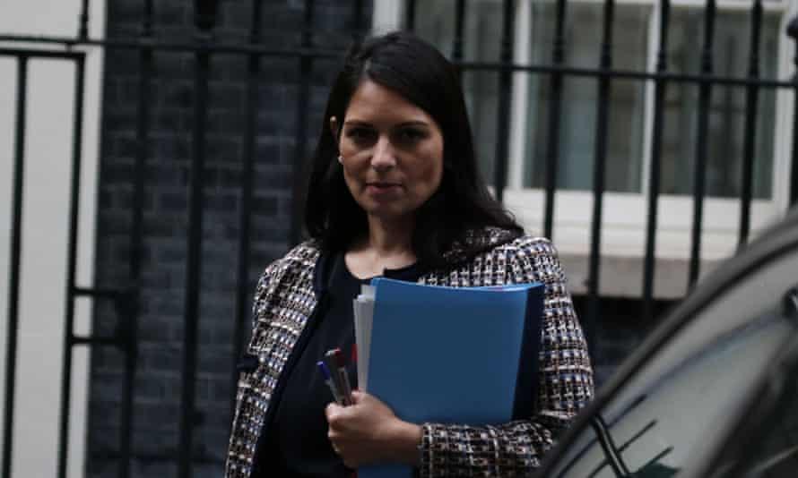 Priti Patel holding a folder leaving Downing Street