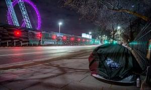 A rough sleeper near the London Eye.