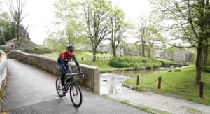 Chris Froome rides through Linton, during the team launch.