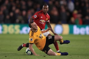 Ashley Young of Manchester United fouls Diogo Jota.