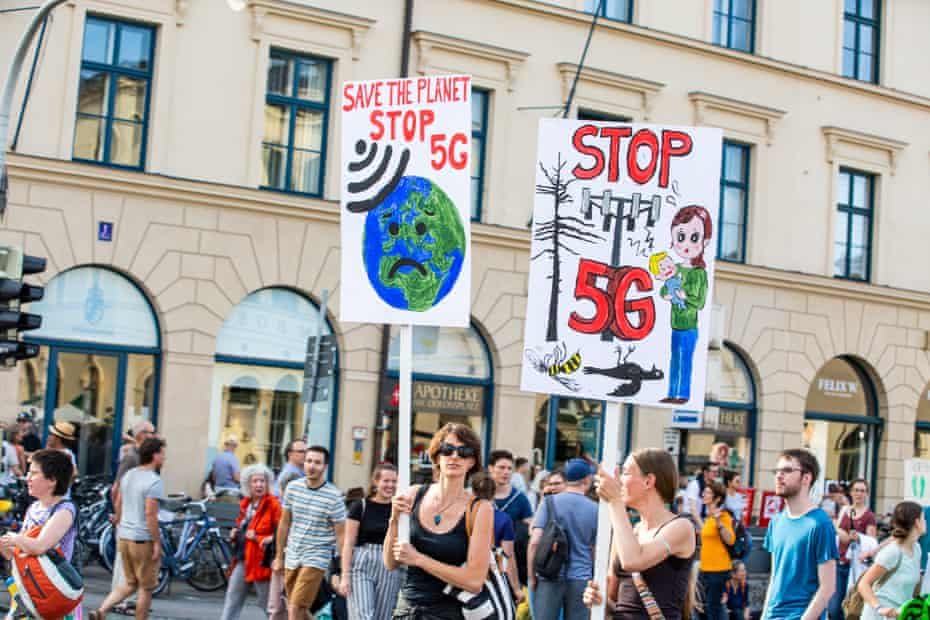 Protesters hold signs opposition 5G at a climate change rally in Munich, Germany.