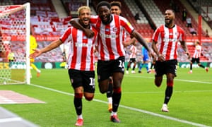 Brentford's Said Benrahma (left) celebrates scoring his side's third goal of the game and his hat-trick with team-mates Josh Da Silva and Ollie Watkins.