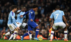 Chelsea's Willian (centre) vies with Manchester City's David Silva (left), Benjamin Mendy and Raheem Sterling.
