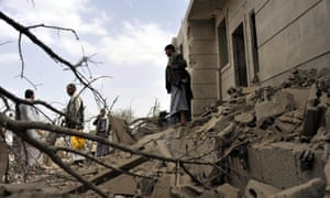 Yemenis inspect destroyed houses after a Saudi-led air strike in al-Jiraf district in Sana'a.