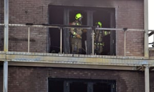 Firefighters in burnt-out flat