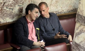 Greek Finance Minister Tsakalotos and former Finance Minister Varoufakis talk during a parliamentary session in Athens