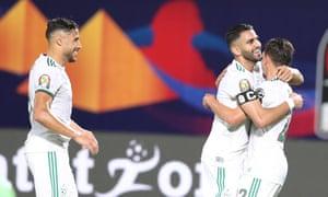 Riyad Mahrez (centre) celebrates with teammates as Algeria beat Kenya 2-0 in Cairo.