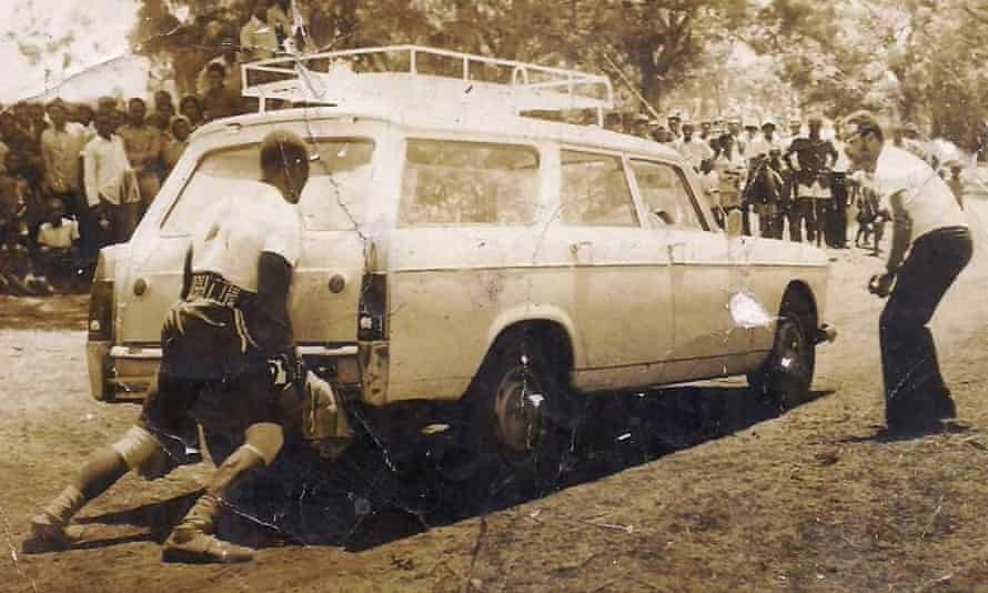 'Sunlight' Okiror is seen lifting a car, one of the feats he was famous for in Uganda during the 1970s.