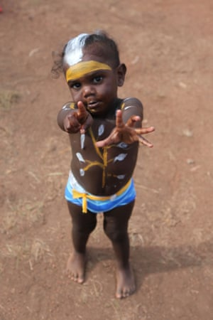 A young dancer poses for a picture before joining his family on the bunggul ground. 15 Yolngu clans gather at Garma, sharing culture and teaching the young kids.
