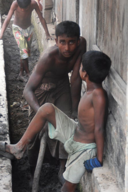The youngest members of the Rohingya community clear out the storm ditches.