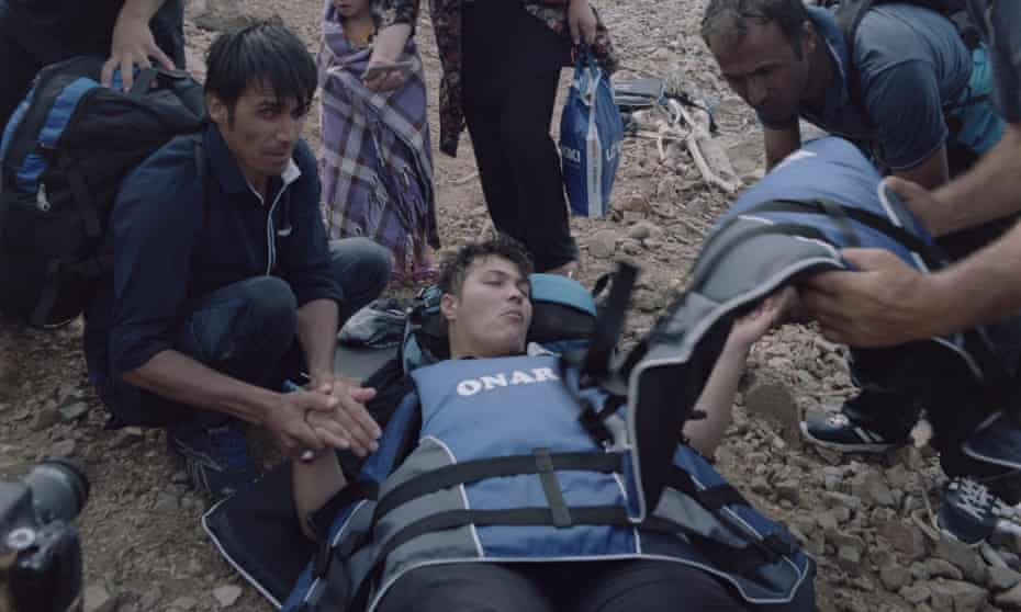 An Afghan refugee who lost consciousness after landing near Molyvos, July 2015 .