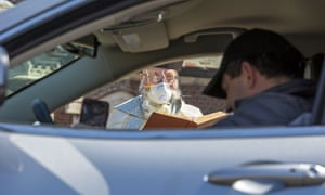 Due to the coronavirus pandemic, parishioners remained in their cars for the blessing.