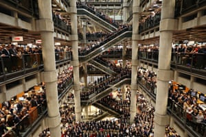 London, England: Brokers and underwriters  line the balconies and escalators of the Lloyd's of London building