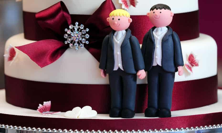 Groom cake decorations on a wedding cake.