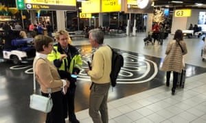 People inside the terminal of Amsterdam's Schiphol airport. Police initially said they were investigating a 'suspicious situation'.