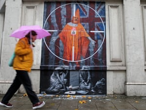 London, UK: A pedestrian passes a mural of the WikiLeaks founder, Julian Assange, near Westminster magistrates court, where he was due to appear