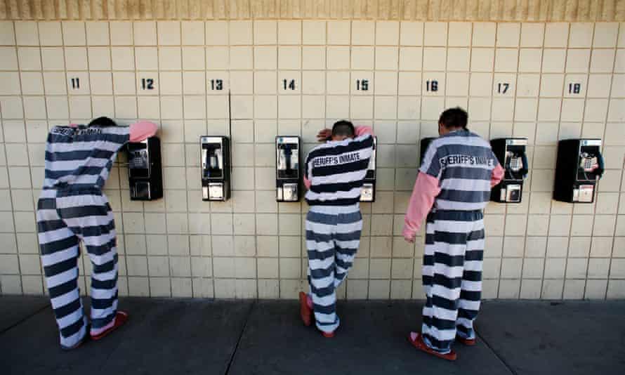 Inmates talk on pay phones in Maricopa County jail in Phoenix, Arizona.