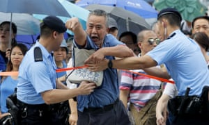 A supporter of Hong Kong's government shouts at pro-democracy protesters outside the Legislative Council complex.
