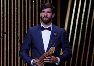 Liverpool's Alisson Becker with the Yachine trophy.