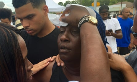 Sterling's aunt, Veda Washington, being consoled by friends.