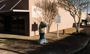 Cement catfish sculptures are displayed on several street corners in downtown Belzoni.