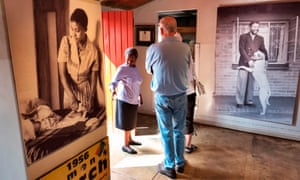Tourists browse the exhibits inside Mandela's former home in Soweto, which is now a museum.