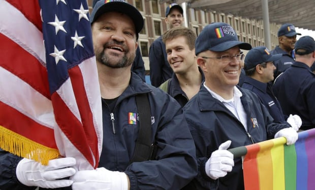 Former troops march with a group representing LGBT military veterans in a Veterans Day parade in Boston.