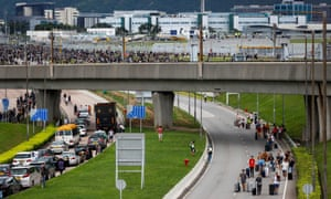 Travellers attempt to reach the airport after protesters blocked roads