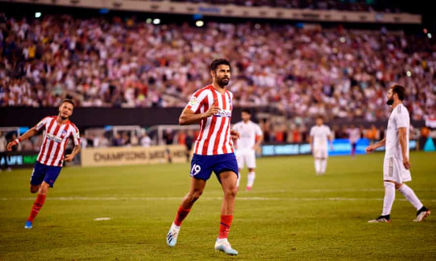 Diego Costa celebrates after his second goal of four scored before he was sent off in the 65th minute.
