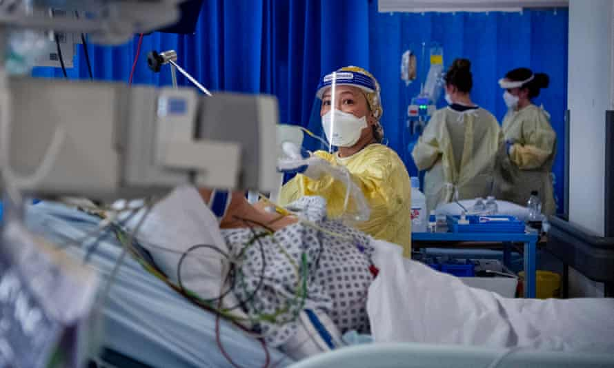 A nurse works on a patient in the ICU at St George's Hospital in Tooting.