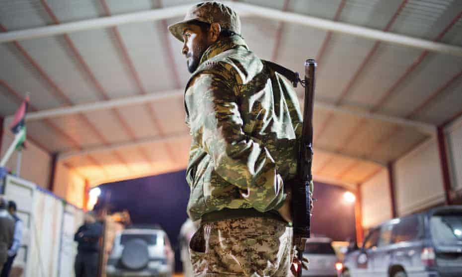 A Libyan soldier stands guard 68 miles from Isis-occupied Sirte.