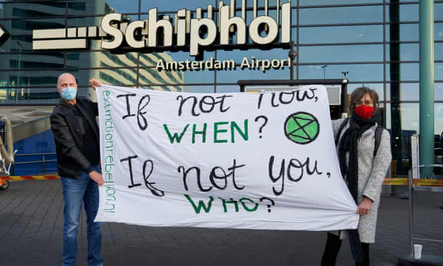 Extinction Rebellion activists protesting against climate pollution at Schiphol airport in the Netherlands.