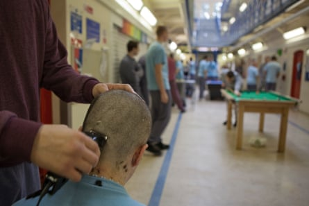 An inmate having his head shaved at Aylesbury young offender institution, 2009.