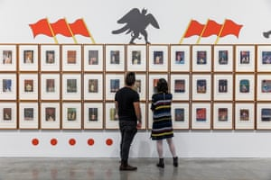 The wall of postcards at MCA making up the work Two Finger Exercises (1989) by Guan Wei.