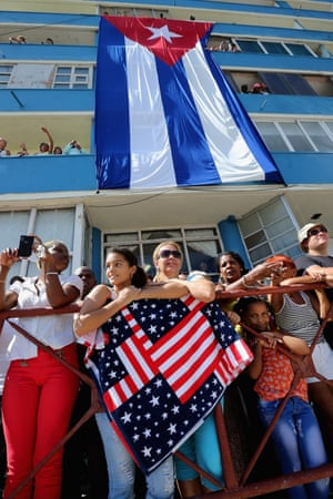 Hundreds of Cubans and visitors from other countries gather across the street from the newly reopened US Embassy.