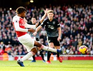 Alex Iwobi slams the ball home for Arsenal's third.