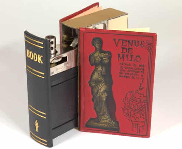"""A table lighter, disguised as """"The Book of Smoking Knowledge,"""" circa 1960s."""
