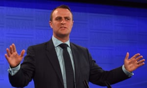 Tim Wilson speaks at the National Press Club in Canberra while human rights commissioner