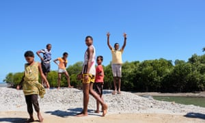Jona Ratu's children, standing on what was once a beach