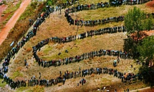 People queue to cast their votes in Soweto in the 1994 election