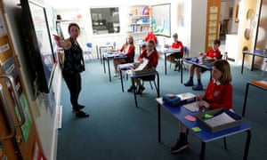 Children spaced out in classroom