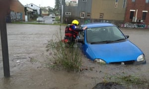 Authorities assist in floodwaters in Wallsend, a suburb of Newcastle.
